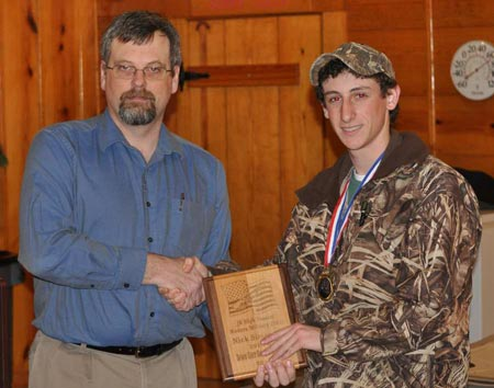 DEGS President Chris Kurek presents the award for 2014 Junior Shooter High Score to Nick Simonetti
